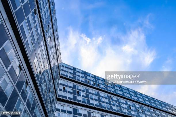 low angle view of modern building against sky - geneva switzerland stock pictures, royalty-free photos & images