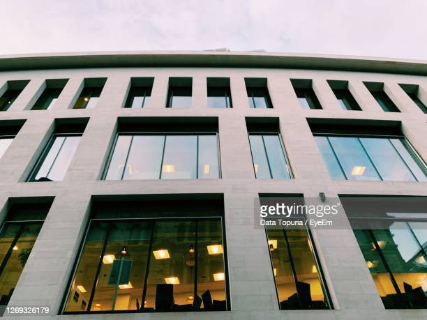 low angle view of modern building against sky - data topuria stock pictures, royalty-free photos & images