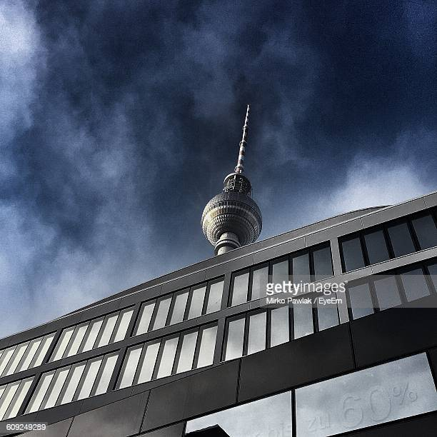 Low Angle View Of Modern Building By Fernsehturm Against Sky