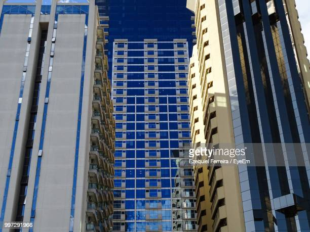 low angle view of modern building in city - barueri stock pictures, royalty-free photos & images