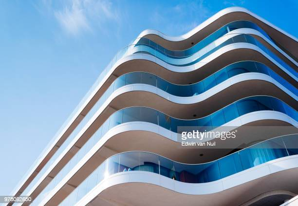 low angle view of modern building, leeuwarden, the netherlands - curve stock pictures, royalty-free photos & images