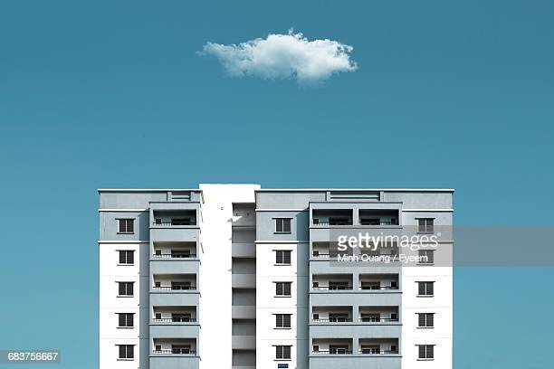 low angle view of modern building - high section stock pictures, royalty-free photos & images