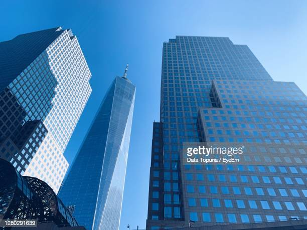 low angle view of modern buildings against blue sky - data topuria stock pictures, royalty-free photos & images