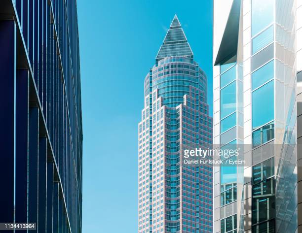 low angle view of modern buildings against clear blue sky - frankfurt main tower stock pictures, royalty-free photos & images