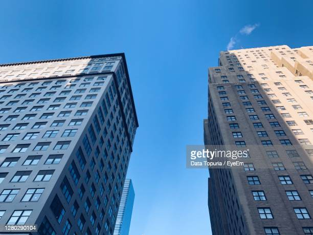 low angle view of modern buildings against clear blue sky - data topuria stock pictures, royalty-free photos & images