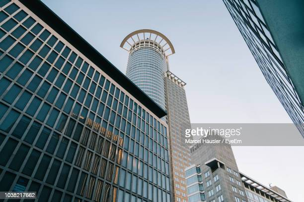 low angle view of modern buildings against clear sky - frankfurt main tower stock pictures, royalty-free photos & images