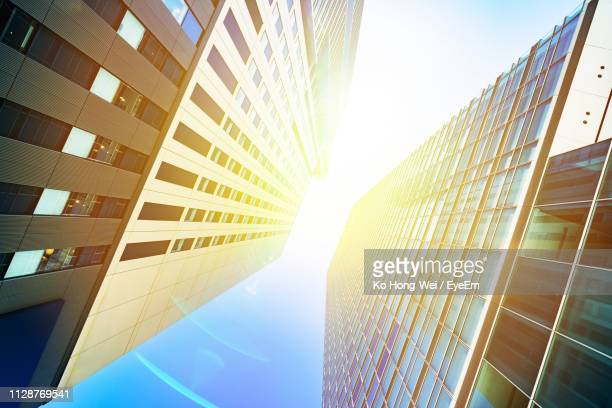 low angle view of modern buildings against clear sky - 埼玉県 ストックフォトと画像