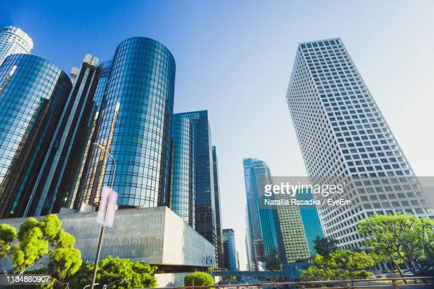 low angle view of modern buildings against clear sky - low angle view stock pictures, royalty-free photos & images