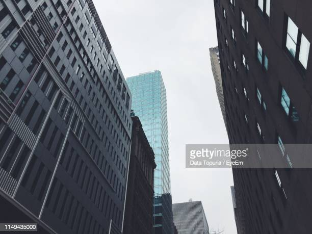 low angle view of modern buildings against clear sky - data topuria stock pictures, royalty-free photos & images
