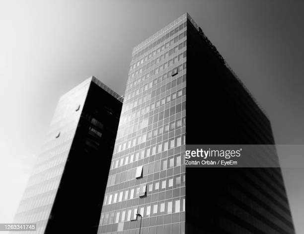 low angle view of modern buildings against clear sky - budapest stock pictures, royalty-free photos & images