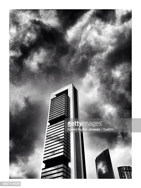 low angle view of modern buildings against cloudy sky - noemi foto e immagini stock