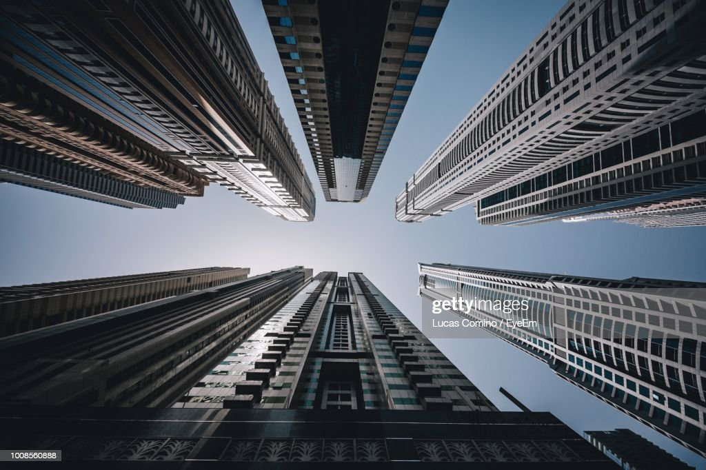 Low Angle View Of Modern Buildings Against Sky In City : Stock Photo