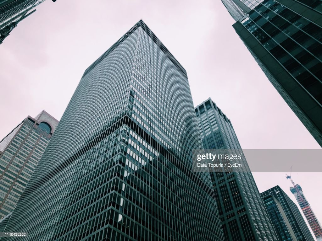 Low Angle View Of Modern Buildings Against Sky In City : Foto de stock