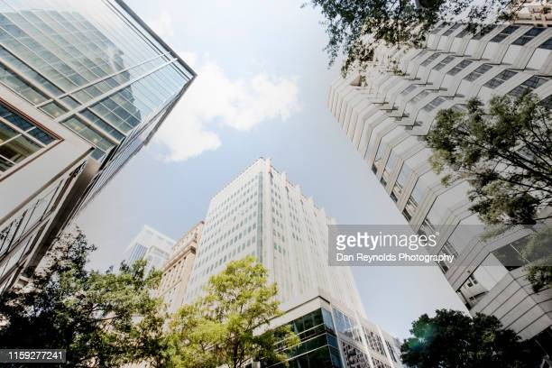 low angle view of modern buildings against sky in city - north carolina amerikaanse staat stockfoto's en -beelden