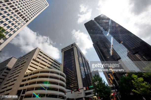 low angle view of modern buildings against sky in city - charlotte north carolina stock pictures, royalty-free photos & images