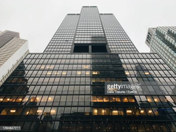 low angle view of modern buildings against sky in city - data topuria stock pictures, royalty-free photos & images