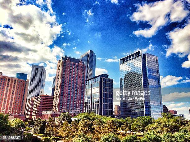 low angle view of modern buildings against sky in city - atlanta georgia stock pictures, royalty-free photos & images
