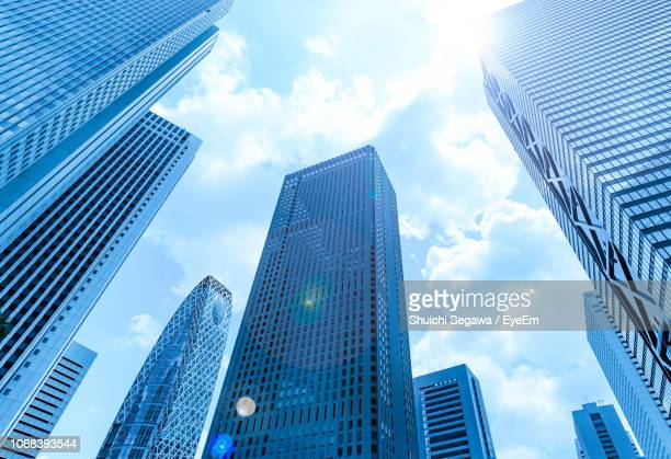 low angle view of modern buildings against sky - skyscraper imagens e fotografias de stock
