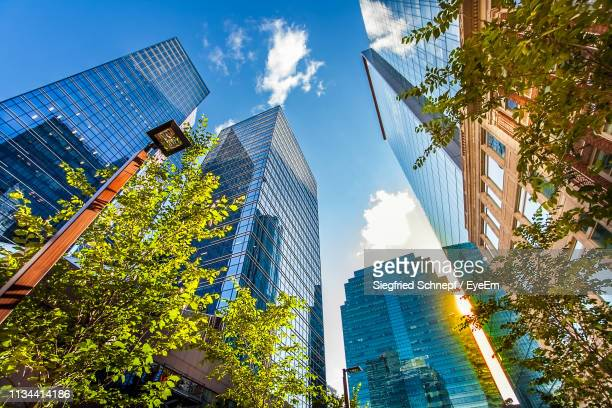 low angle view of modern buildings against sky - edmonton stock pictures, royalty-free photos & images