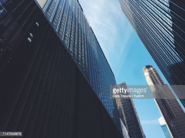 low angle view of modern buildings against sky - data topuria stock pictures, royalty-free photos & images
