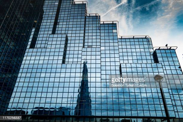 low angle view of modern buildings against sky - solomon turkel stock pictures, royalty-free photos & images