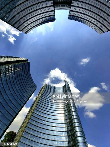 low angle view of modern buildings against sky - skyscraper foto e immagini stock