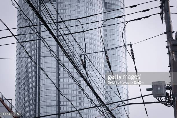 low angle view of modern buildings against sky - seiichiro hayashi ストックフォトと画像