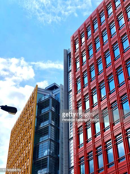 low angle view of modern buildings against sky - holborn stock pictures, royalty-free photos & images