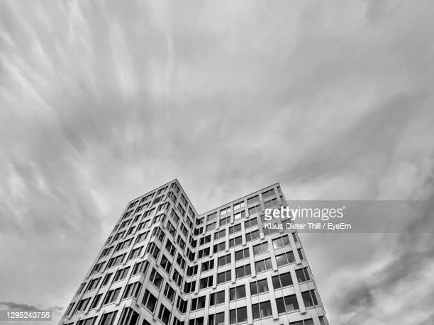 low angle view of modern buildings against sky - klaus-dieter thill stock-fotos und bilder