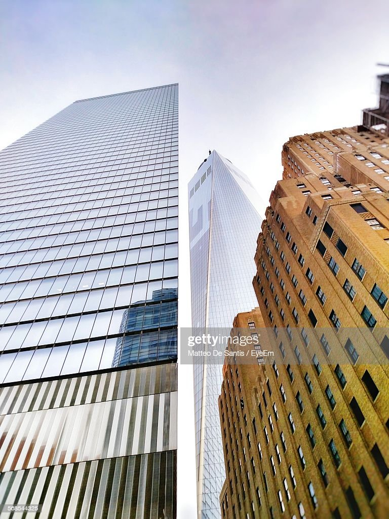 Low Angle View Of Modern Buildings Against Sky : Stock Photo