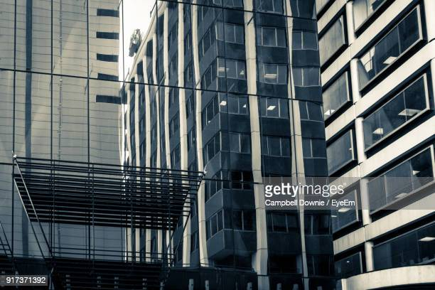 low angle view of modern buildings in city against sky - campbell downie stock pictures, royalty-free photos & images