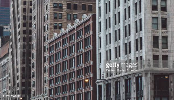 low angle view of modern buildings in city - bortes stock pictures, royalty-free photos & images