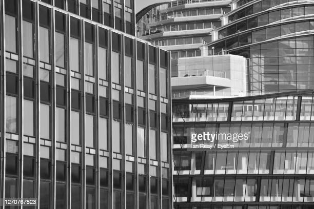 low angle view of modern buildings in city - greater manchester stock pictures, royalty-free photos & images