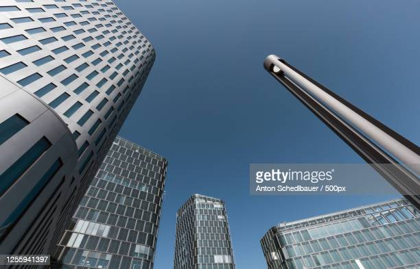 low angle view of modern buildings - anton schedlbauer stock-fotos und bilder