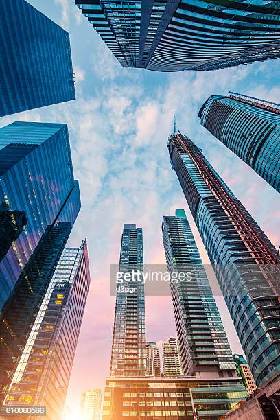 low angle view of modern corporate skyscrapers, with modern glass windows facade and urban architectural designs in toronto downtown during sunrise. - bank financial building stock pictures, royalty-free photos & images