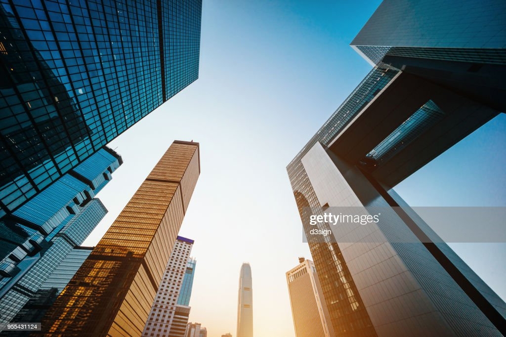 Low angle view of modern financial skyscrapers in Central Business District, Hong Kong at sunrise : Stock Photo