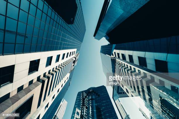 Low angle view of modern financial skyscrapers into the sky