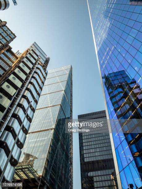 low angle view of modern futuristic skyscrapers in the city of london, england, uk - london england stock pictures, royalty-free photos & images