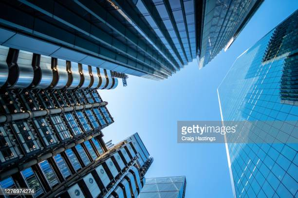 low angle view of modern futuristic skyscrapers in the city of london, england, uk - brexit stock pictures, royalty-free photos & images