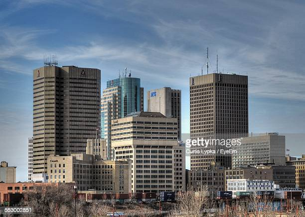 low angle view of modern office buildings - winnipeg stock pictures, royalty-free photos & images