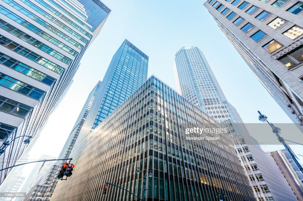 Low angle view of modern office buildings skyscrapers in Manhattan Midtown, New York : Stock Photo