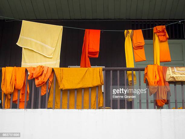 low angle view of monk robes and towel drying in balcony - drying stock pictures, royalty-free photos & images