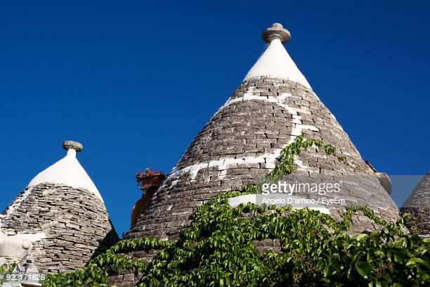 low angle view of monument against clear blue sky - alberobello stock pictures, royalty-free photos & images
