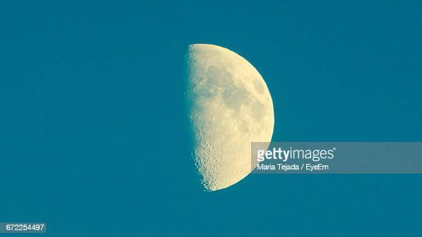 low angle view of moon against clear blue sky - maria tejada stock pictures, royalty-free photos & images