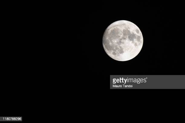 low angle view of moon against clear sky at night - mauro tandoi foto e immagini stock