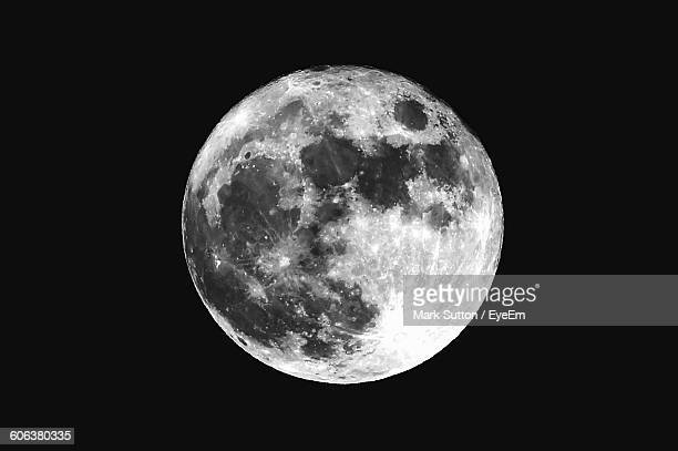 low angle view of moon against clear sky at night - moon stock pictures, royalty-free photos & images