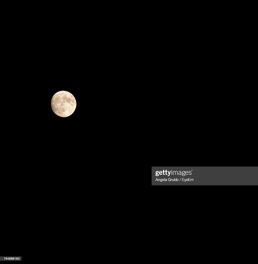 Low Angle View Of Moon Against Clear Sky At Night : Stock Photo