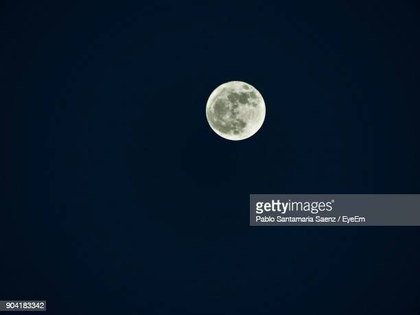 low angle view of moon against clear sky at night - moonlight stock pictures, royalty-free photos & images