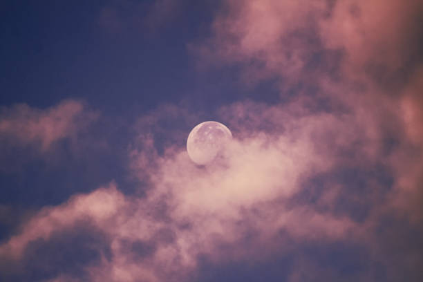 Low Angle View Of Moon Against Sky At Morning