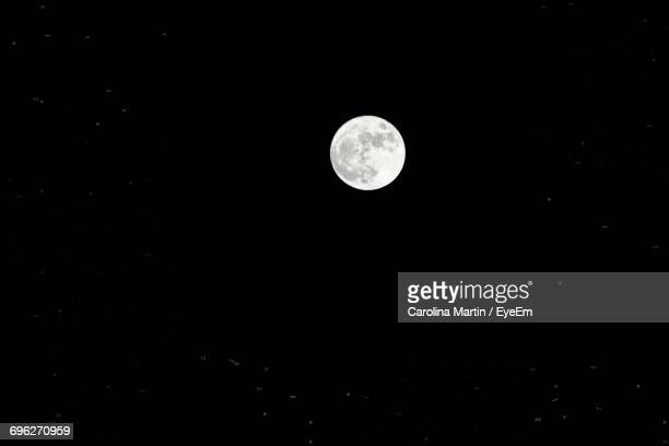 Low Angle View Of Moon Against Sky At Night
